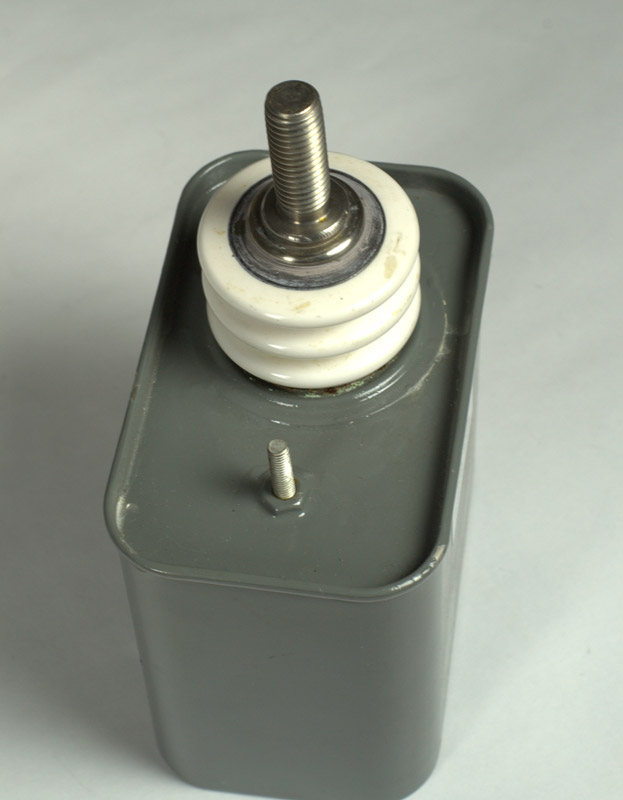 High Voltage Capacitors : S series capacitors drawn can economical package